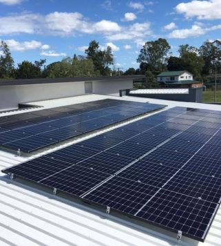 Mono Solar Panels on White Tin Roof